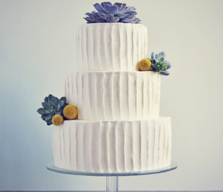 Wedding cake with succulents and craspedia