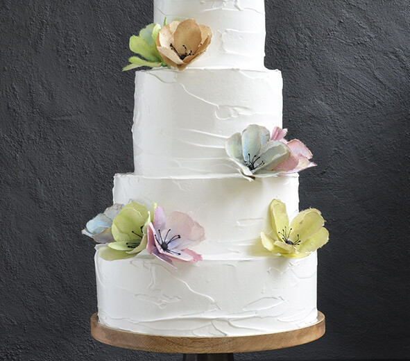Wedding cake with meringue frosting and aquarel flowers
