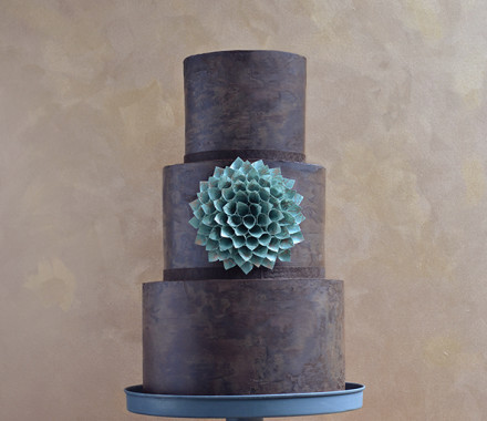 Gluten-free chocolate wedding cake with paper flower