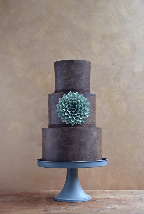 Gluten-free chocolate wedding cake with paper flower