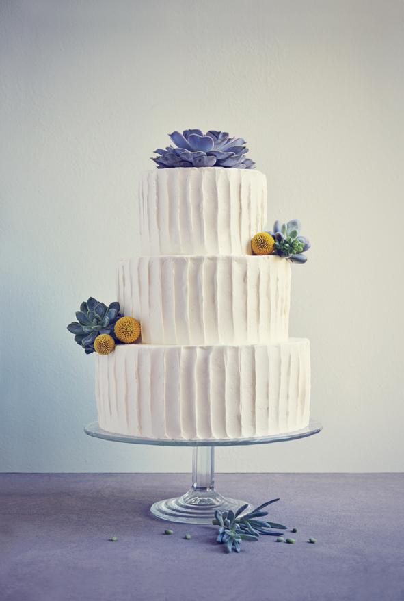 Wedding cake with succulents and craspedia